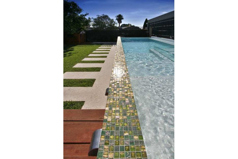 Bisazza mosaic blend makes up the border of this swimming pool