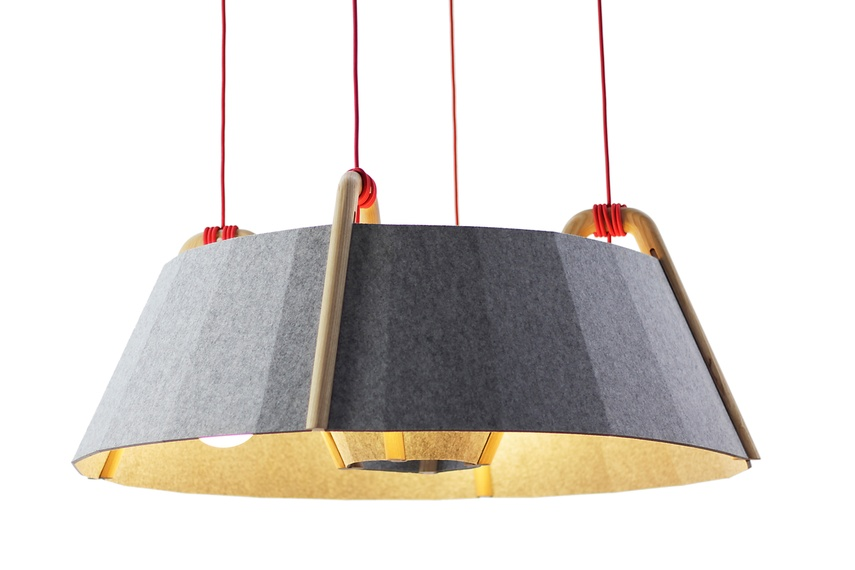 The faceted shape of the recycled polyester felt shade helps reduce ambient noise.
