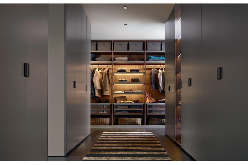 The innovative walk-in closet was created for orderly storage.