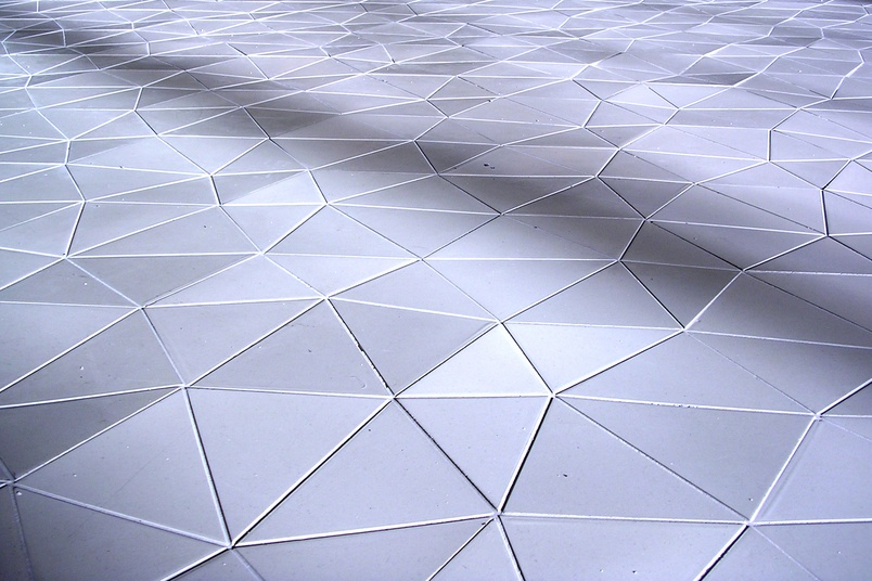 Each tile is a hexagon that has been subdivided into six triangles.