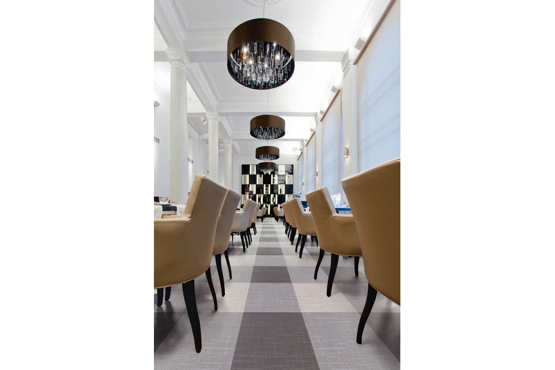 Expona Linné in a restaurant setting in light grey and dark grey.