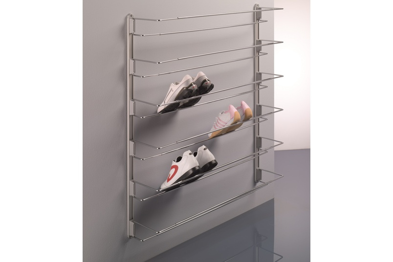 Ambos front-mounted shoe rack on wall with guides.