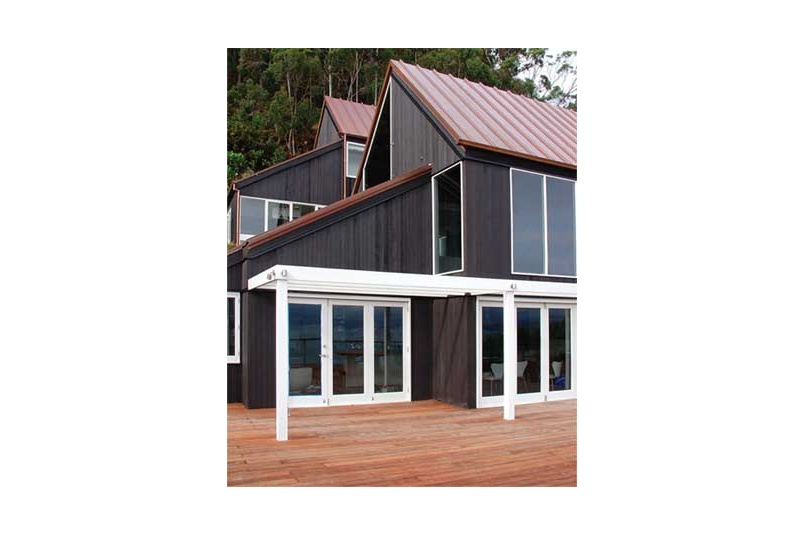 Exterior timber stained in Resene Waterborne Woodsman CoolColour tinted to Resene Pitch Black