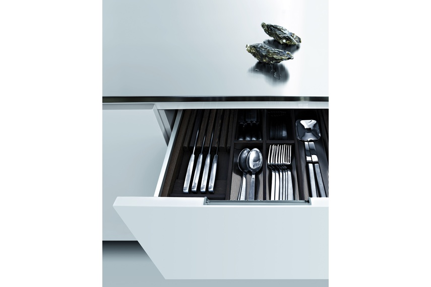 The kitchen features storage solutions that can be customised with the addition of exclusive accessories.