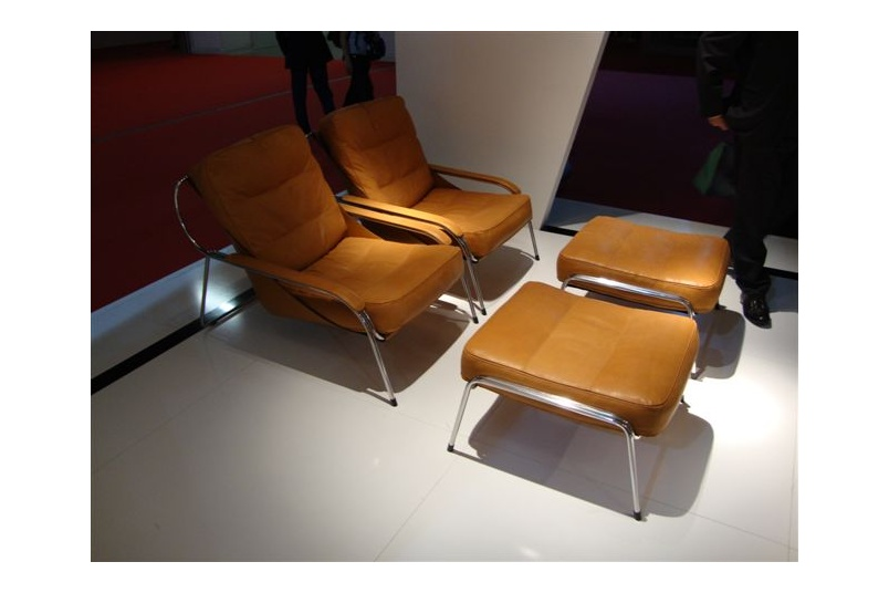 The Maggiolina chair has leather upholstery with feather fill cushions.